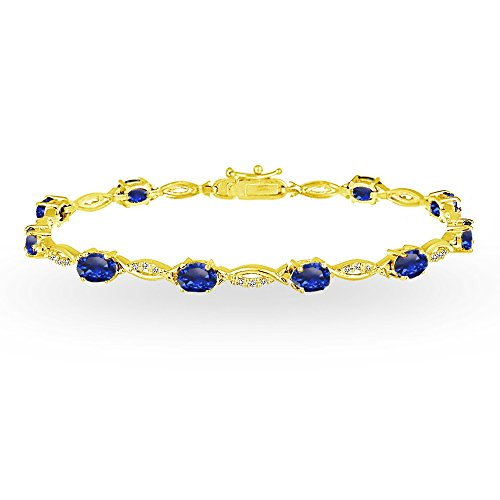 GemStar USA Yellow Gold Flashed Sterling Silver Created Blue Sapphire and White Topaz Oval-Cut Swirl Tennis Bracelet ()