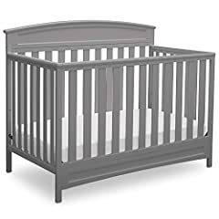 Create a warm and welcoming space for Baby with the Sutton 4-in-1 Convertible Baby Crib from Delta Children. Designed with style and safety in mind, it features a classic shape with intricate detailing at the headboard and three adjustable he...