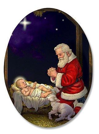 kneeling santa in manger humble adoration infant christ 3 inch oval magnet