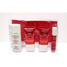 Clarins Paris Skin Care Set - Includes: Cleansing Milk Normal or Dry Skin 1.7 Fl. Oz., Super Restorative Night Wear 0.53 Fl. Oz., Super Restorative Day Cream 0.53 Fl. Oz., and Super Restorative Serum 0.33 Fl. Oz.