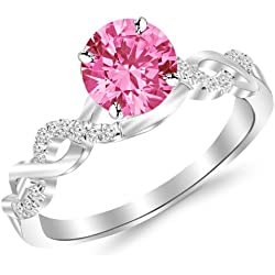 0.88 Carat 14K White Gold Twisting Infinity Gold and Diamond Split Shank Pave Set Diamond Engagement Ring with a 0.75 Carat Natural Pink Sapphire Center (Heirloom Quality)