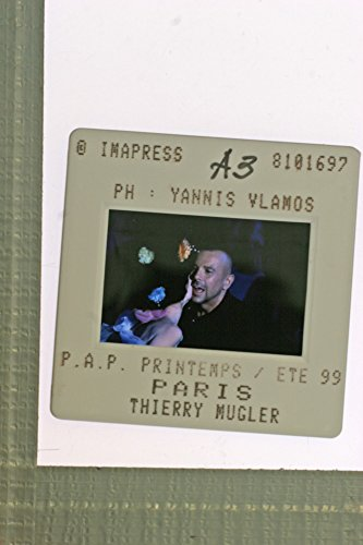 Slides photo of Thierry Mugler greeted a woman at the Paris Fashion Week, 1999. -
