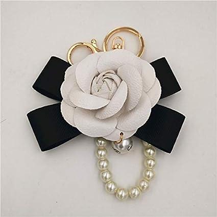 Rarido Famosa marca llavero negro blanco cuero camelia flor ...
