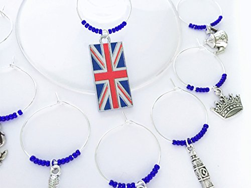 Great Britain Gift, London Wine Charms. London gift. Includes: Union Jack, Big Ben, Royal Crown, British Rose, Teapot, Double Decker Bus, Royal Guard. Set of 8. BLUE BEADS.
