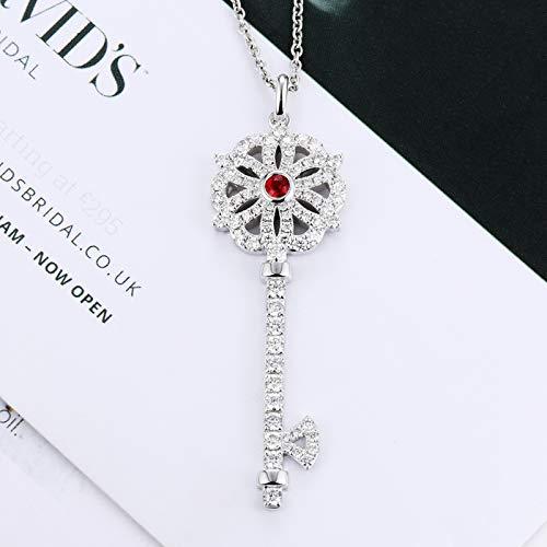 (Unique 18k platinum dove hematite key pendant