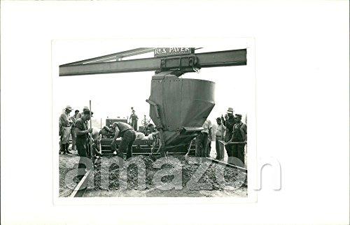 vintage-photo-of-men-building-a-road-pouring-cement-rex-paver-adt-651