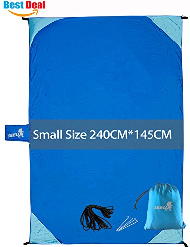 Waterproof Beach Blanket Portable - Lightweight Compact Sand Proof Beach Blanket Mat for Travel, Camping, Hiking, Outdoor Picnic Blanket with Pockets, Loops, Bag & Ropes, 7' x 9'- Fit 4-6 People