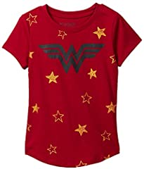 DC Comics girl's t-shirt with Wonder Woman logo - officially licensed. There are glittery gold stars on the front. Lightweight fabric, short sleeves, crew neck and rounded bottom hem. Girl's sizing for approximate ages 6 to 14 years old. Mach...