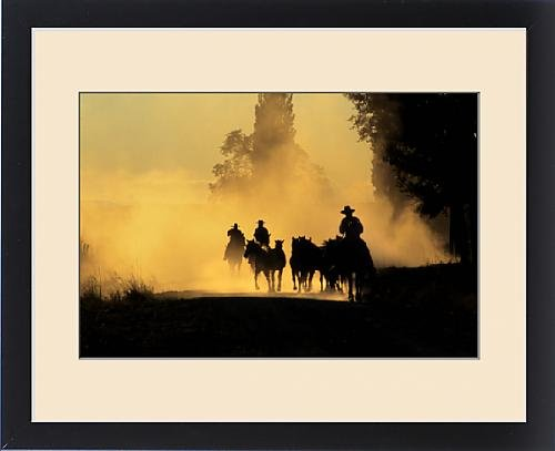 Framed Print of USA, Oregon, Burns. Cowboys driving wild horses down dirt road by Fine Art Storehouse