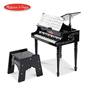 Here's an elegant introduction to playing the piano. The classically styled grand piano features a lifting top with a safety hinge, 30 piano keys, a songbook with a color-coded key chart, and a sturdy, non-tipping bench. This Melissa & Doug child...