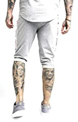 This Performance Sweat Shorts from Sik Silk comes in Grey Marl colour, featuring an embroidered logo on front. This pair of shorts features open side pockets and an elasticated drawstring waist. These sweat shorts also sports branding down bo...