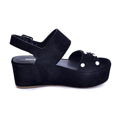 Sandali Docksteps da donna in camoscio nero con piccole borchie piatte in acciaio. Chiusura con cinturino alla caviglia, zeppa comoda da 7cm.