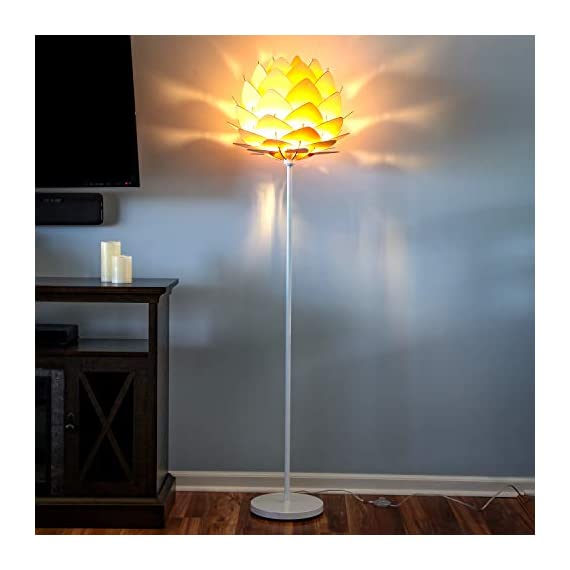 Brightech Artichoke LED Floor Lamp- Unique Contemporary Standing Light for Living Room, Bedrooms- Modern Multi-Panel Style Wooden Shade – Tall Pole Uplight Lamp - UPRIGHT LAMP FOR CONTEMPORARY DECOR: The Artichoke LED Floor Lamp has a stunning sculptural design that will upgrade your space in a unique and creative way. It pairs well with modern, mid-century, Scandinavian, and Asian style décor. The pole has a white finish, which helps provide a clean, sleek look and fits perfectly with the inviting tone of the warm white LED light the bulb emits. ALEXA & GOOGLE HOME COMPATIBLE WARM READING LIGHT FOR HOME OR OFFICE: Works with smart outlets that are Alexa, Google Home Assistant, or Apple HomeKit enabled, to turn on/off. (Requires smart outlet sold separately.) The Artichoke Lamp gives off warm, cozy light without producing a harsh glare and creates a comfortable space beside your book chair; it's a great alternative to unpleasant overhead lights. FITS EASILY NEXT TO A SIDE TABLE, BED, DESK, OR COUCH: This lamp is lightweight, weighs only 12.5 pounds, and reaches just over five and a half feet tall, so that it is easy to move around to where light is needed most in your room. Its slender design makes it easy to place near love seats, sofas, armchairs, side tables, and desks. The lamp has a weighted base that prevents tipping, and the convenient to use on/off pedal switch allows you to easily tap the lamp on or off with your foot. - living-room-decor, living-room, floor-lamps - 41LoNQ25iBL. SS570  -