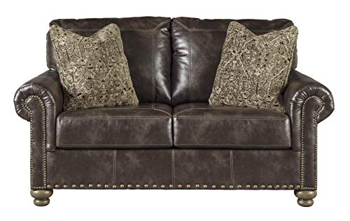- Ashley Furniture Signature Design - Nicorvo Traditional Faux Leather Loveseat with Nailhead Trim - Coffee