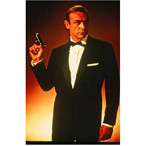 Sean Connery 8 inch x10 inch Photo from Slide Negative, Full Frame, w/White Borders 007 Indiana Jones Highlander Hunt for Red October in Black Tux Holding Gun Up at Shoulder Height Head Turned Left kn