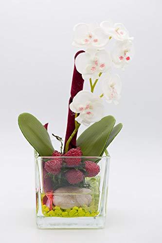 Centro de mesa con una planta de orquídea blanca en un cubo de ...