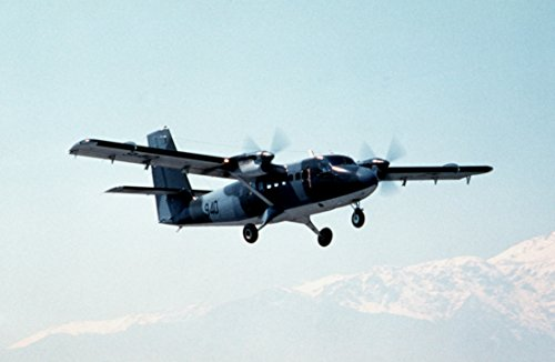 A Chilean De Havilland Canada DHC-6 Twin Otter aircraft flies over snow-capped mountains during (De Havilland Canada Twin Otter)