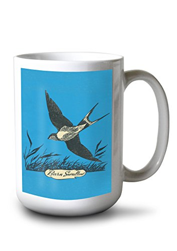 Lantern Press Nature Magazine - View of a Swallow Diving Above a Grassy Field (15oz White Ceramic Mug)