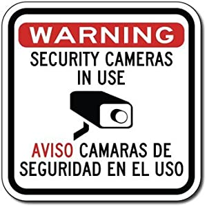 amazoncom bilingual security cameras in use sign