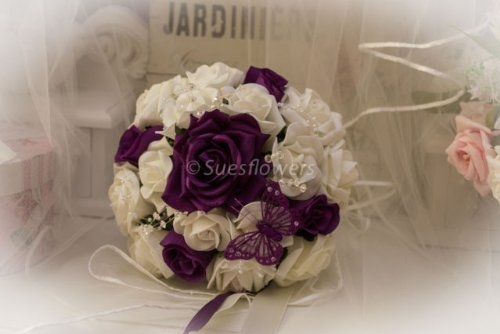 WEDDING FLOWERS BRIDESMAID BOUQUET IN CADBURYS PURPLE AND IVORY ROSES