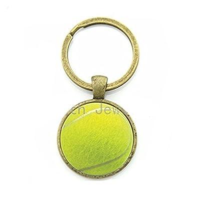 Elegante Casual Deportes Pelota de tenis foto clave cadena ...
