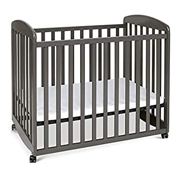 Image of Baby Davinci Alpha Mini Rocking Crib in Espresso | Removable Wheels | Greenguard Gold Certified