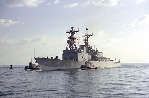 Home Comforts A pair of commercial tugs escort the destroyer USS MOOSBRUGGER (DD-980) into port. The ship is curre