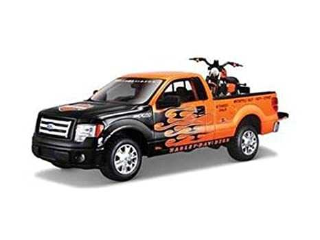 Amazon Com 2010 Ford F 150 Stx Pickup 1 27 Orange With Flames