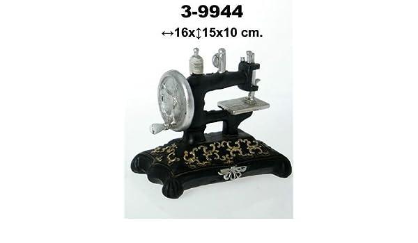 DonRegaloWeb - Figura de una máquina de coser antigua de resina decorada con colores negro, plata y dorado: Amazon.es: Hogar