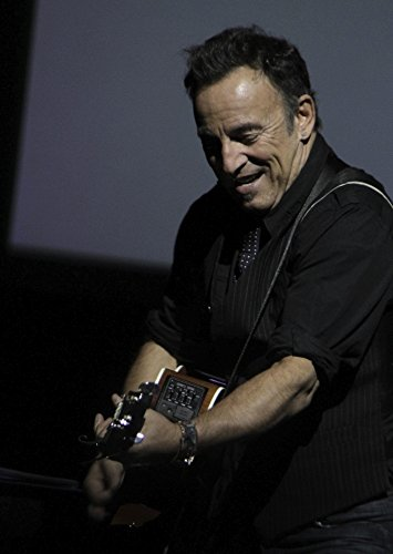 Bruce Springsteen performing at the Sixth Annual Stand Up for Heroes Photo Print (8 x 10)