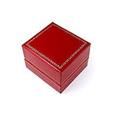 Red leatherette with gold trim on the outside edges. Box comes with a white 2 piece outside box packer.