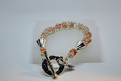 Silver plated wire knitted Bracelet with Millefiori glass cube beads.