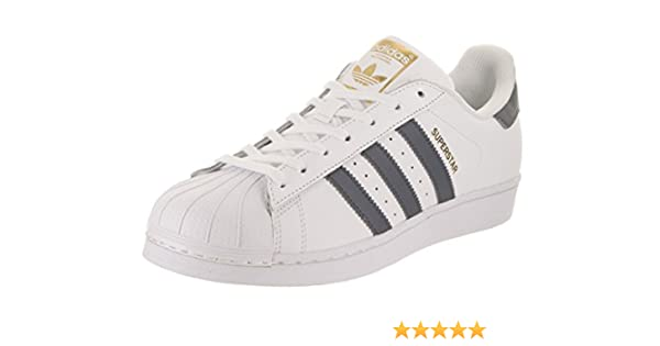 huge selection of 949cc 06d42 Amazon.com   adidas Superstar Foundation Mens in White Onix Metallic Gold,  7.5   Fashion Sneakers