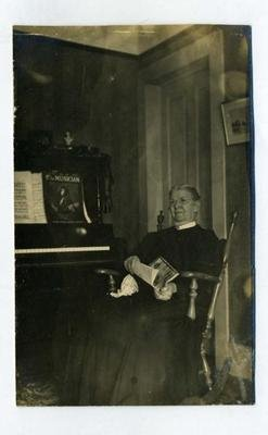 Woman in Rocking Chair by Piano with Sheet Music Real Photo Postcard