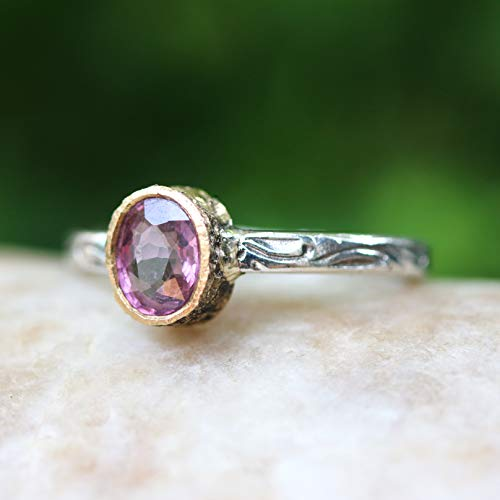 Oval cut pink spinel ring in 18k gold bezel setting with sterling silver in leaf design engraving band ()