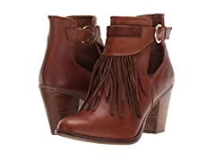Dress for the season in the buckled fringed leather Sbicca™ Bathilda boots with chic cut-out detail and breathable man-made lining with lightly cushioned, stationed insole. Part of the Sbicca Vintage Collection. Stacked heel with man-m...