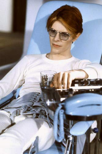 David Bowie in The Man Who Fell to Earth cool in sunglasses in chair 24x36 Poster