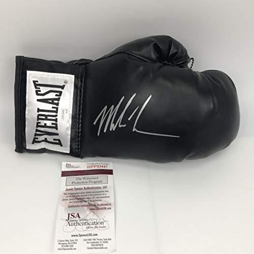Autographed/Signed Mike Tyson Black Everlast Boxing Glove JSA COA