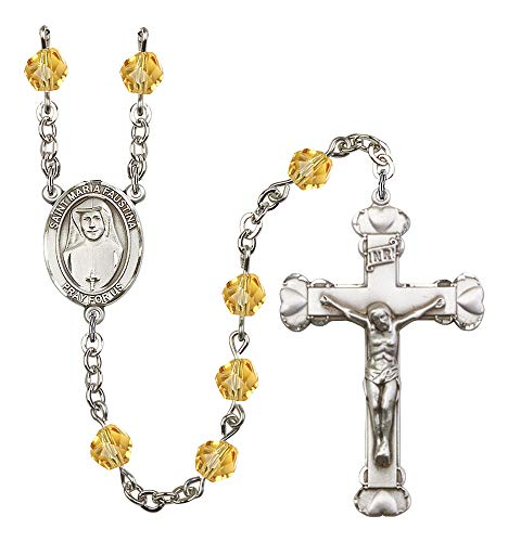 Silver Plate Rosary features 6mm Topaz Fire Polished beads. The Crucifix measures 1 5/8 x 1. The centerpiece features a St. Maria Faustina medal. Patron Saint Apostle of Divine - Apostles Divine Mercy