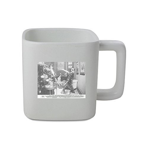 11oz square shaped mug with Brigitte Bardot in costume, having good time with man.