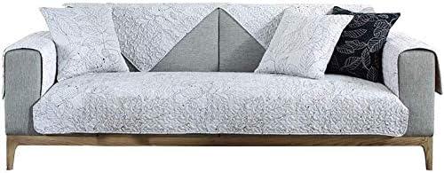 Sofá cubierto sección en forma de L, colchas movimiento de los ...