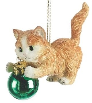 orange tabby kitten playing with green ornament cat christmas tree ornament