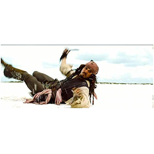 Pirates of the Carribean: The Curse of the Black Pearl Johnny Depp as Captain Jack Sparrow on the Ground Action Shot 8 x 10 Inch Photo