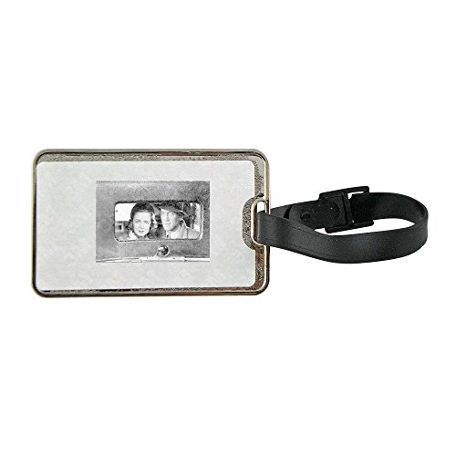 Metal luggage tag with Jimmy Stewart and Donna Reed in the movie It's A Wonderful Life