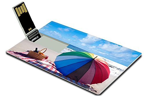 Luxlady 32GB USB Flash Drive 2.0 Memory Stick Credit Card Size Picnic background with basket fruits book and umbrella by the ocean IMAGE 37053522