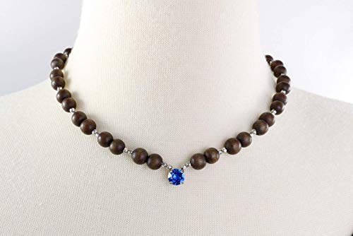 Boho Bling Capri Blue Crystal & Wood Necklace, Genuine 8mm Swarovski Crystal strung with 8mm sepia brown wood beads adding a touch of softness to this piece. Bohemian Crystal and Wood Jewelry