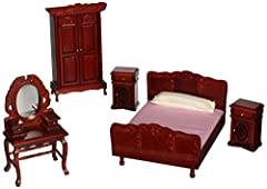 This elegant five-piece bedroom set is full of tasteful touches. This set includes soft, durable bedding for the queen-sized bed and a reflective mirror on the dressing table. The handcrafted wooden pieces are exceptionally detailed with bras...