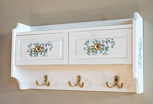 wall-cabinet-in-white-with-blue-green-floral-stenciling