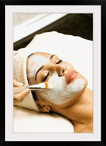 GreatBIGCanvas ''Woman receiving facial treatment at spa'' Photographic Print with Black Frame, 24'' x 36''