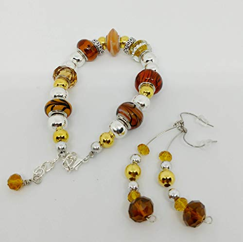 statement necklace Triple strand necklace set with pierced drop earrings amber acrylic beads and gold beads.